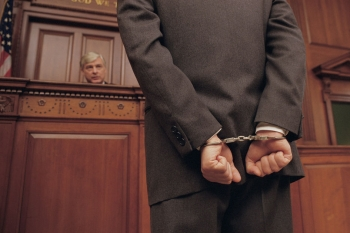 A Man in Handcuffs Stands Before a Judge